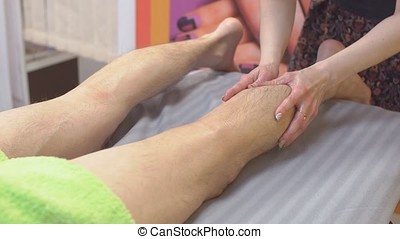 Man Relaxing with Massage at Beauty Spa.