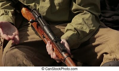 Man Reloads Old Rifle - Soldier in the forest recharges...