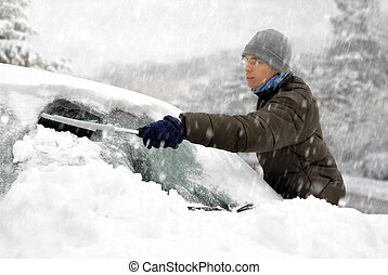 Man removes snow from his car
