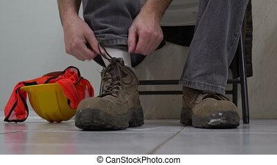 Man Removes Workboot Massages Foot