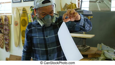 Man removing color sticker from skateboard 4k - Man removing...