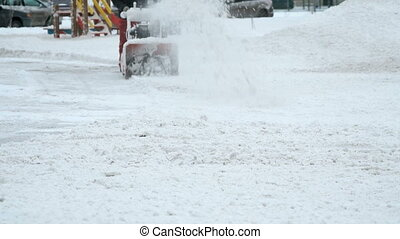 Man removing snow with snow plow machine - Winter cleaning. ...