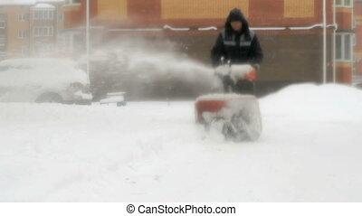 Man removing snow with snow plow machine - Winter cleaning....