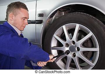Man repairing a car wheel