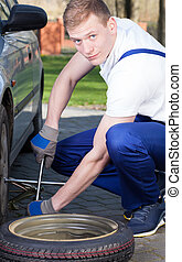 Man repairing a tire