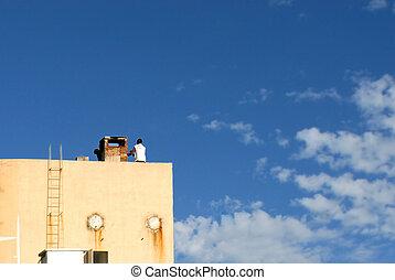 Man repairing chimney on a water tank
