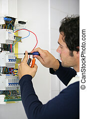 Man repairing faulty fuse box
