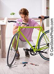 Man repairing his broken bicycle