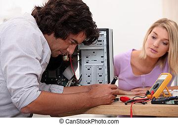 Man repairing his computer.