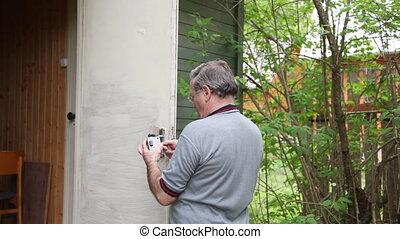 Man repairing lock