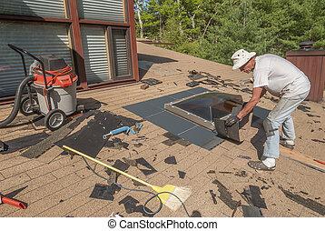 Man repairing roof skylight flashing