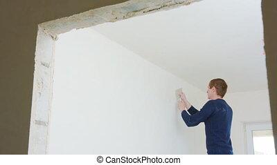 Man Repairing the Room - Man repairing the room. Decoration