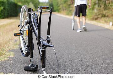 man reparing bike