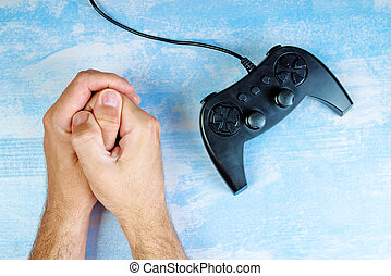 Man resisting video game addiction