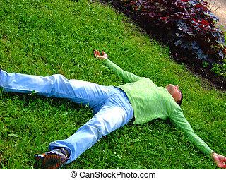 Man rest on a grass.