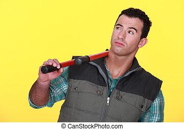 Man resting bolt cutters over shoulder