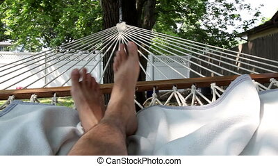 Man Resting in Hammock