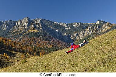 man resting in mountain landscape