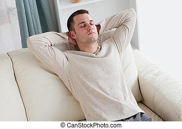 Man resting on a sofa