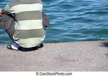 man resting on lake