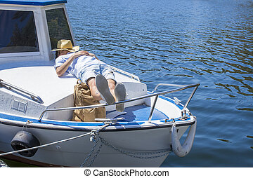 man resting or sleeping on the yacht, summer vacation