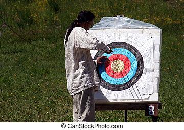 man retrieving arrow