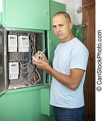 Man rewrites electrical meter readings