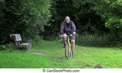 Man ride bicycle in the park