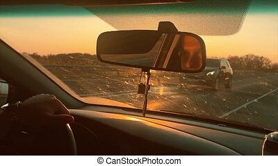 man rides on an auto beautiful sunlight silhouette of...