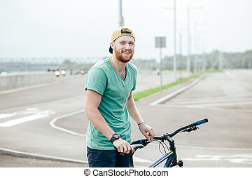 Man riding a bicycle on a road