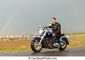 Man riding a motorcycle on the country road