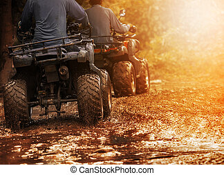 man riding atv vehicle on off road track ,people outdoor...