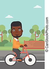 Man riding bicycle.