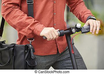 Man Riding Electric Scooter Closeup