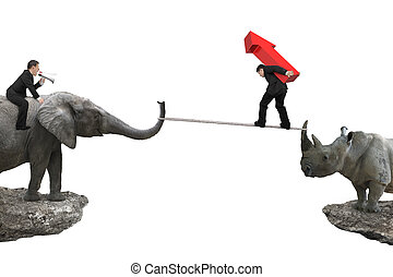 Man riding elephant against rhinoceros another man carrying arrow up