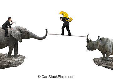 Man riding elephant against rhinoceros another man carrying dollar sign