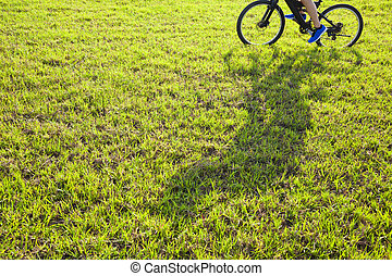 man riding on a meadow with shadow