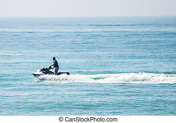 Man riding on water scooter in the sea.