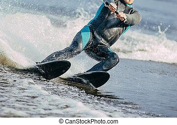 man riding on water skis