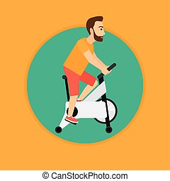 Man riding stationary bicycle.