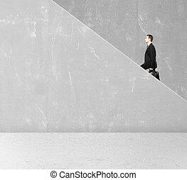 man rises on cocnrete ledder
