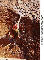 man rock climbing