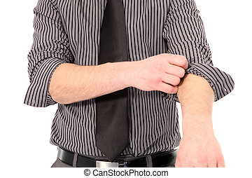 Cropped torso portrait of a young man in a tie rolling up his shirt sleeves isolated on white