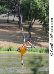 man rope jumping with a rope in the water