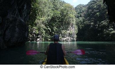 man rowing kayak in the lagoon