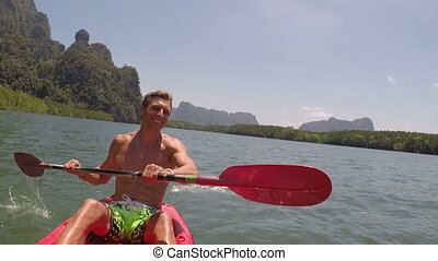 Man Rowing Kayaking In Beautiful Lagoon Action Camera POV Of Young Guy Paddling On Kayak Boat