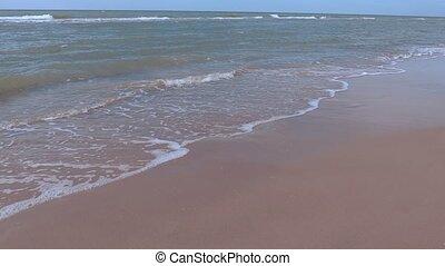 Man run by the sea
