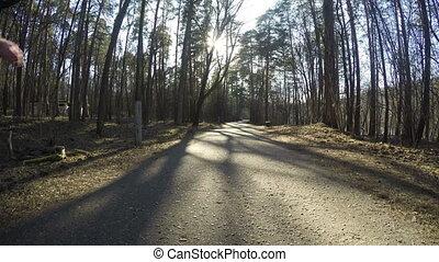 man run with sportswear  around the forest path. 4K