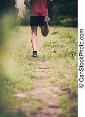 Man runner cross country running on trail