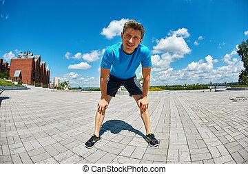 man runner warming up before jogging